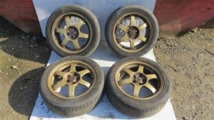 GENUINE RAYS RE010 FORGED GOLD 5x100 ALLOY WHEELS WITH TYRES